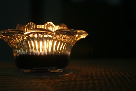 Candle Light with a lotus holder in a dark room