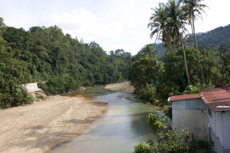River pass by a village in Malaysia  Stock Photo