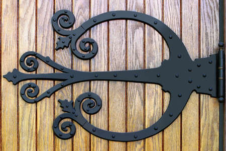 wrought: Ornate Wrought Iron Doorhinge - Close-up on a Church entrance in rural Iowa