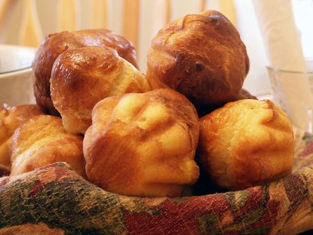 Brioches - a tasty traditional French pastry eaten at breakfast time, dipped either in hot chocolate or coffee usually along with jam or jelly. It is as much appreciated as croissants, and sure is delicious! Stock Photo
