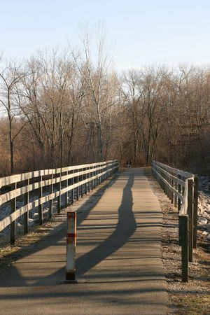 Wooden Bridge - At sunset near the dam area, Coralville, Iowa photo