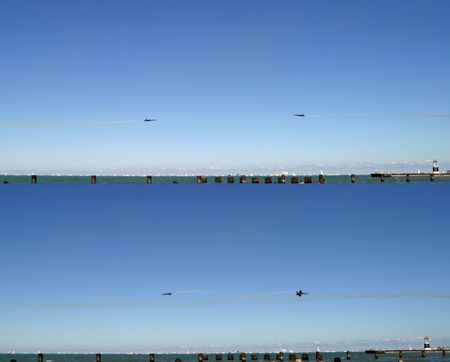 Facing Duo - Two-picture montage, taken split-second apart - Blue Angels stunt, Chicago Airshow 2006 Stock Photo - 551152