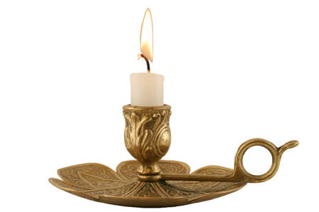 candleholder: Brass Candleholder - horizontal - Decorative antique brass candelabra with brightly lit white pillar candle.  Isolated over white. Stock Photo