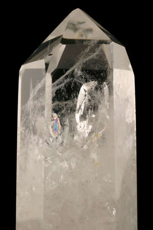 inclusions: Quartz Crystal - Strongly bound structure with fluid inclusions, trigonal symmetry and crystal faces well developed.  Light passes through its geologic intricacy.  Tectosilicate.