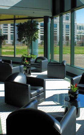 empty lobby of a bank with leather seats and floral design photo