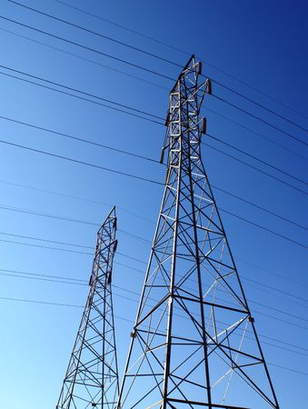 two power pylons against a clear blue sky photo