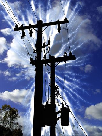 silhoutte of a transformer post struck by lightning photo