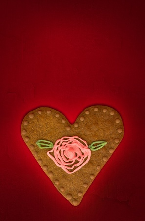 Valentine s day greetings card with cookie on red background