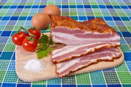 Breakfast - Chopped Bacon, Cherry Tomatoes and Eggs on the Table Stock Photo