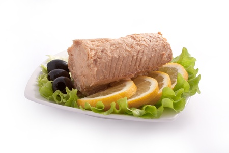 Composition with Canned Pink Salmon Steak Isolated on White Background with Clipping (Work) Path with Lemon, Olives and Salad Leaves