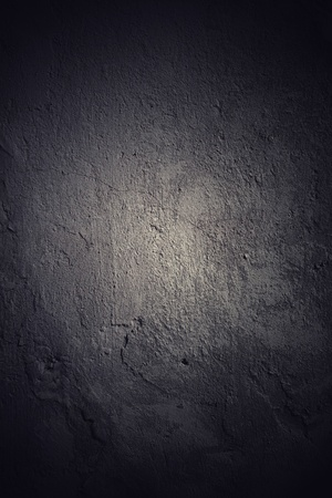 Dark grunge wall background with black vignette photo
