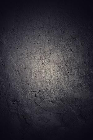 Dark grunge wall background with black vignette