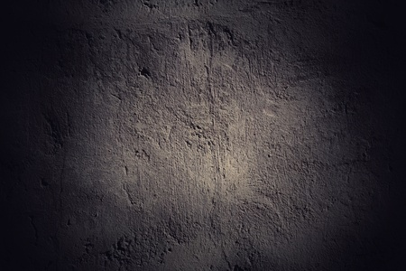 Dark grunge wall background with black vignette