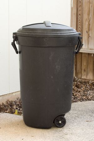wheeled: Wheeled trashcan. Stock Photo