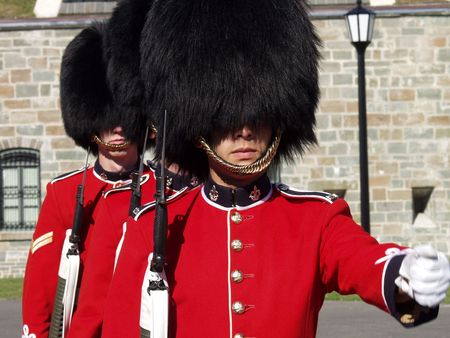 Three members of the Canadian Royal 22nd Regiment changing the guard at the Citadel in Old Quebec City, Quebec, Canada.