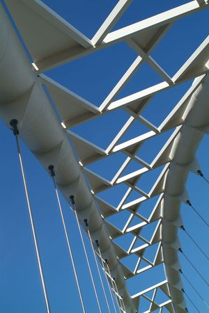 The arc of a modern suspension bridge stands against a clear blue sky in Toronto, Ontario, Canada. Stock Photo