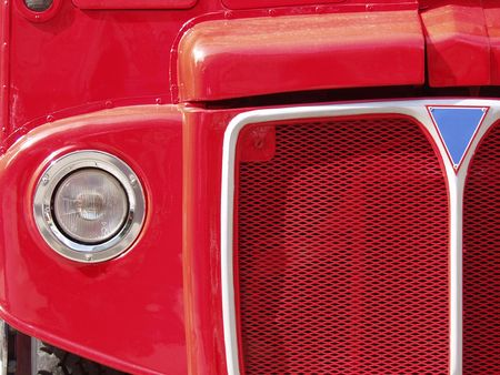 Close-up of the front of a classic red London double-decker bus. photo