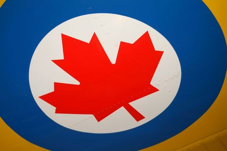 Closeup of the Royal Canadian Airforce roundel on the yellow wing of a training plane. Stock Photo - 562571