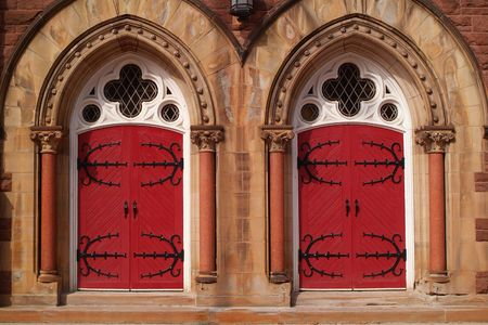Two red doors to a church. photo