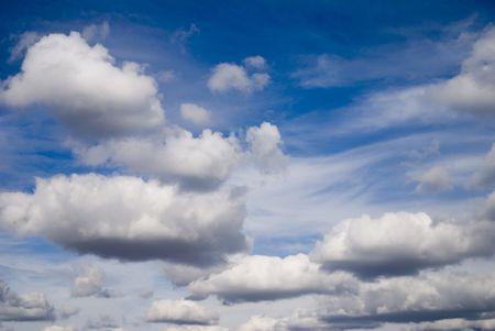 cirrus: Banks of cumulus clouds against a bright blue sky.