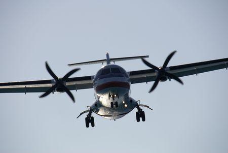 aileron: A twin-engined turboprop passenger plane landing at dusk.