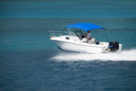 A white speedboat in the Caribbean. Stock Photo