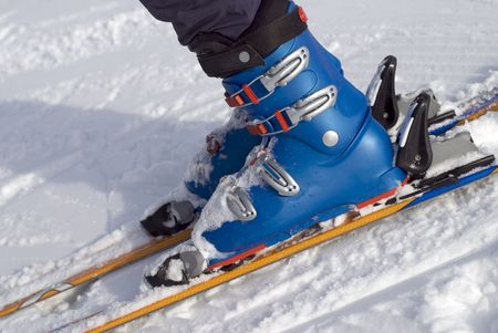 The ski boots of a ten year old girl as she prepares to descend a slope. Stock Photo