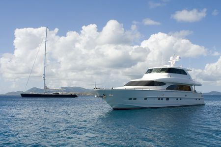Two luxury yachts anchored in the Caribbean.