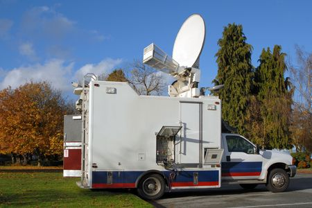 A North American TV news truck in the fall. Stock Photo - 768659