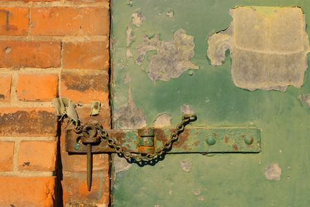 hasp: A hasp and staple on an old warehouse door.