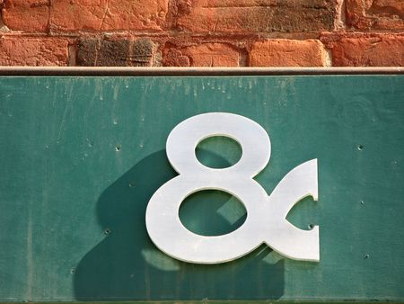 A three-dimensional ampersand. The typeface is Copperplate.