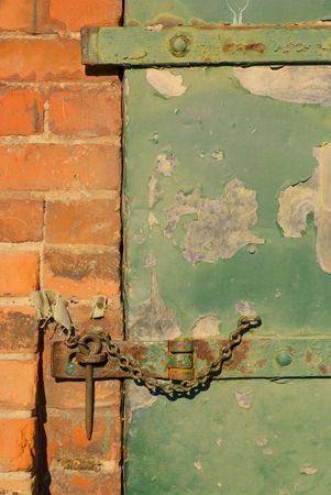 A hasp and staple on an old warehouse door. Stock Photo - 786668