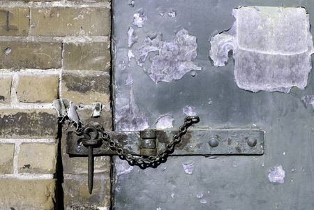A hasp and staple on an old warehouse door. Stock Photo - 795992