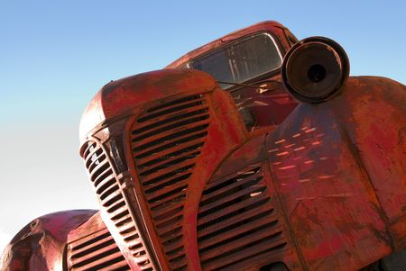 grille: The grille of an old red truck.