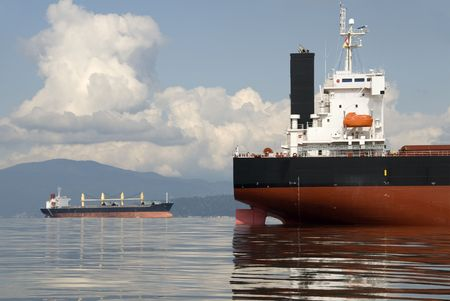 Two empty freighters anchored off the west coast of North America. Stock Photo - 896568