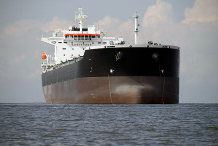 An empty freighter anchored in Canadian waters.  Stock Photo