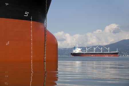 Two empty freighters anchored off the west coast of North America. photo