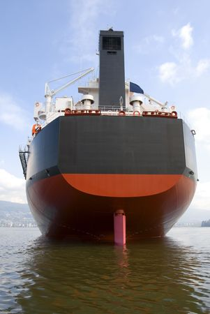 The stern and rudder of an empty freighter anchored off the west coast of North America.