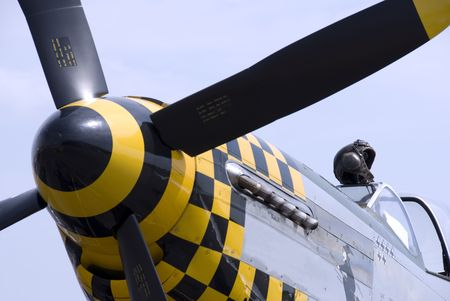 close p: A pilots leather flying helmet sits atop the cockpit of a P-51 Mustang fighter plane.