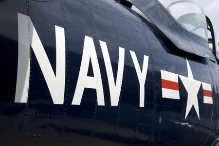 restored: US Navy markings on the side of a restored vintage aircraft.