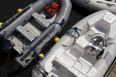 Three inflatable boats tied together in a dock. Stock Photo
