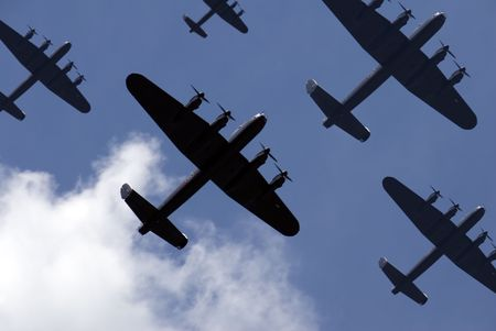 A massed formation of British Lancaster bombers flying overhead. Stock Photo