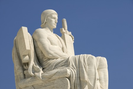 The statue called The Authority of Law at the entrance to the US Supreme Court in Washington, DC. Stock Photo