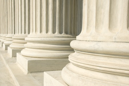 A row of columns at the entrance to the US Supreme Court in Washington, DC. Stock Photo