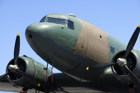 idle: A vintage transport plane stands idle in the sunshine.