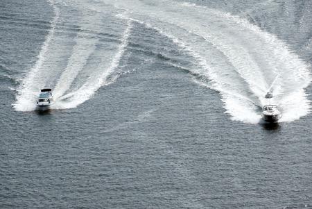 speedboats: Two speedboats racing across a lightly rippled sea.