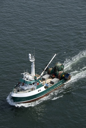 commercial fishing: A commercial fishing boat heading out into the northern Pacific.