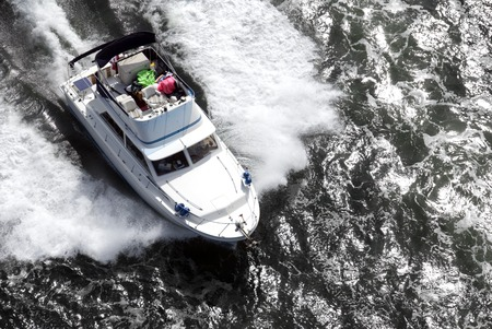 untidy: A white speedboat, with a very untidy upper deck, shot from above while travelling fast. Stock Photo