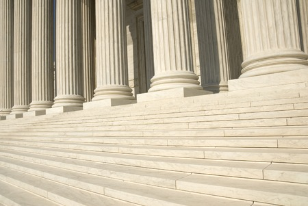 The steps and columns at the entrance to the US Supreme Court in Washington, DC. Stock Photo