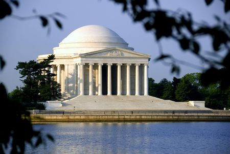 tidal: The Thomas Jefferson Memorial photographed across the Tidal Basin shortly after dawn.